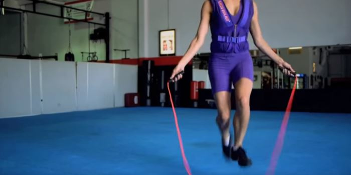 weighted vest woman skipping