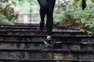female running down steps